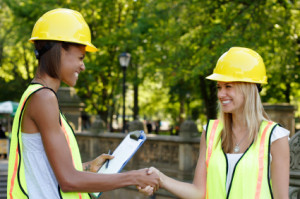 Smiling Utiliity Workers Shaking Hands